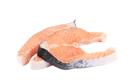 Two fresh salmon steaks. Isolated on a white background. photo