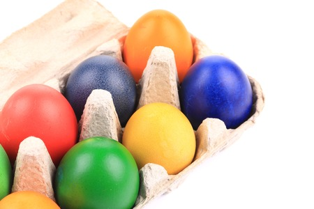 carboard box: Cardboard box with Easter colored eggs. Whole background.