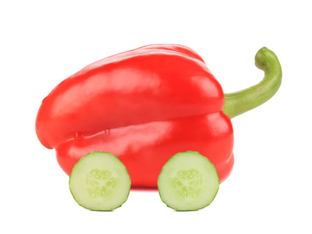 Red bell pepper like a car. Isolated on a white background. photo
