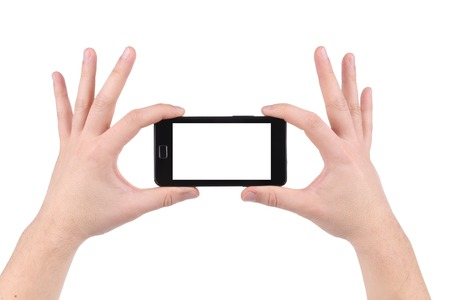 Hands holding smartphone. Isolated on a white background. photo