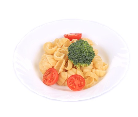 semolina pasta: Tasty itlaian pasta gnocchi with broccoli. Isolated on a white background.