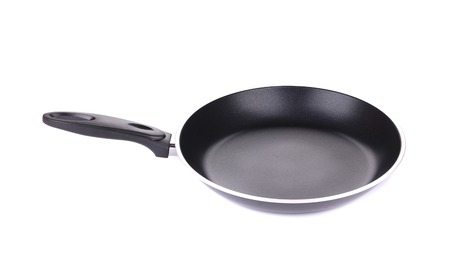 Black metal frying pan. Isolated on a white background. photo