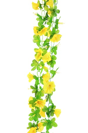 Yellow artificial flowers. Isolated on a white background. photo