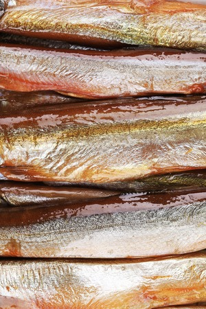 Tasty smoked fish closeup for a background. photo