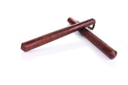 nunchaks: Martial arts nunchaku weapon. Isolated on a white background. Stock Photo