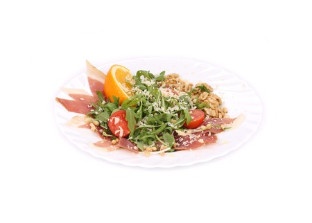 Salad with arugula and prosciutto. Isolated on a white background. photo