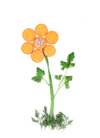 Flower made from vegetables. Isolated on a white background. photo