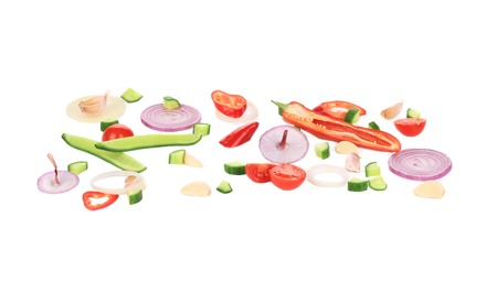 Composition of fresh sliced vegetables. Isolated on a white background. photo