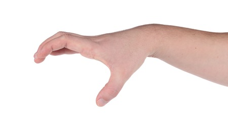 Male hand reaching for something. Isolated on a white background. photo