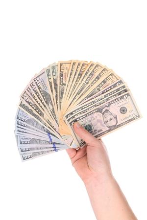 Hand holding dollar bills.
