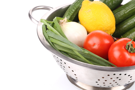 a colander: Vegetables in colander.