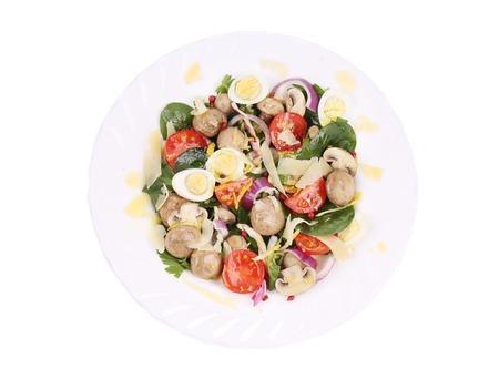 cornsalad: Mushrooms salad with tomatoes and pine nuts.