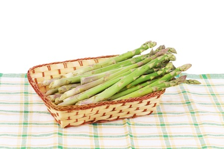 Wicker basket full with asparagus.  photo