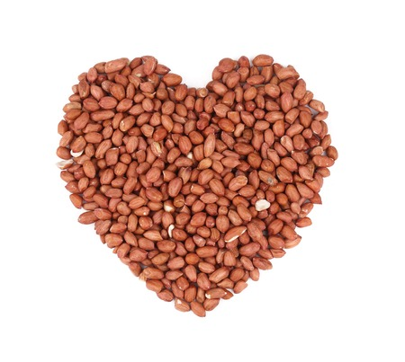 Heart shape of peanuts. Isolated on a white background. photo