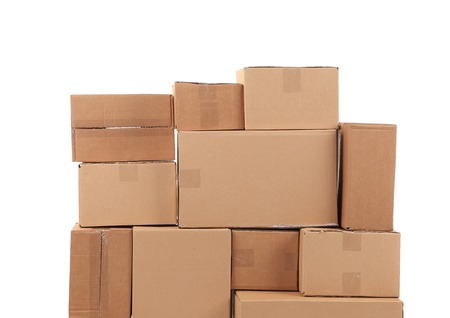 Stacks of cardboard boxes. Isolated on a white background. photo