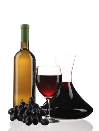 Decanter botle and glass with red wine. Isolated on a white background. photo