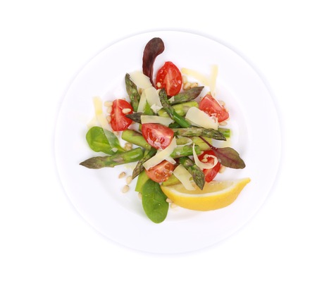 nutritiously: Fresh asparagus salad. Isolated on a white background.