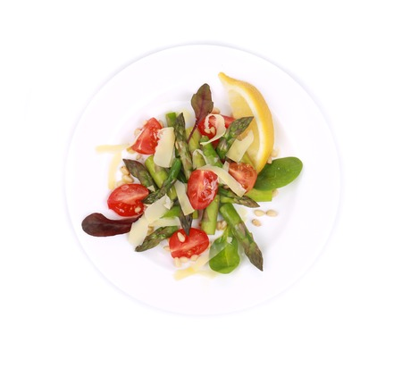 Salad with asparagus. Isolated on a white background. photo