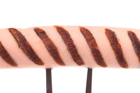 Grilled sausage on a fork.  photo