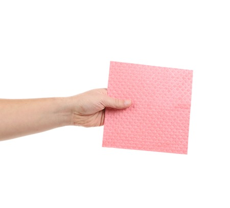 Hand holding pink cleaning sponge. Isolated on a white background. photo