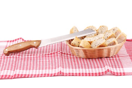 Bread slices in basket on tablecloth  Whole background  photo