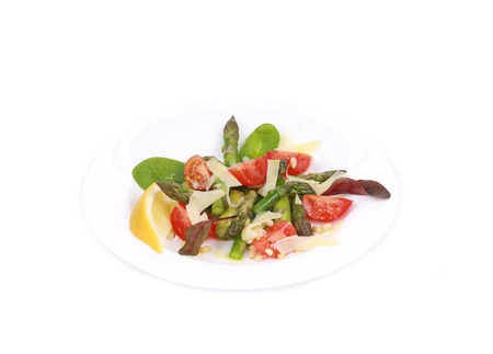 Asparagus salad. Isolated on a white background. photo