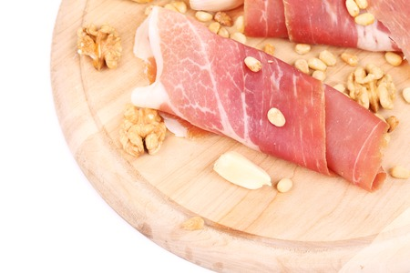 Composition of prosciutto on wooden platter.  photo