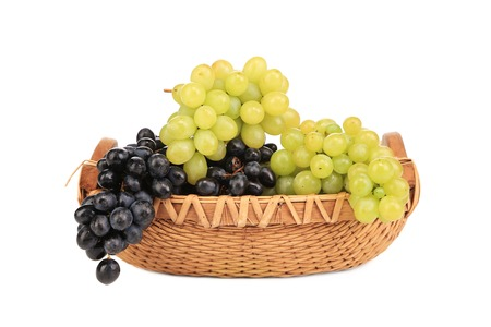 Black and green grapes in basket.  photo