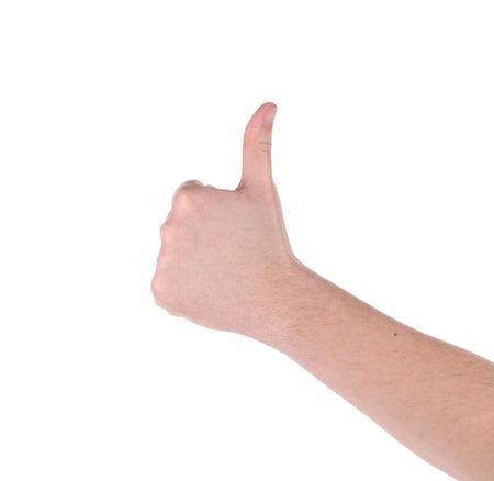 Mans hand showing thumbs up. Isolated on a white background. photo