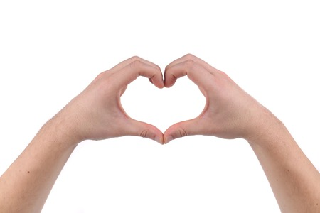 Male hands in the form of heart. Isolated on a white background. photo