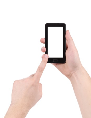 Hand touching screen of smartphone. Isolated on a white background. photo