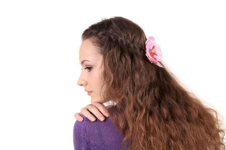Girl hair braid with flower. Isolated on a white background. photo