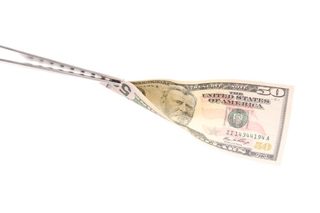 fifty dollar bill: BBQ fork holds fifty dollar bill. Isolated on a white background.
