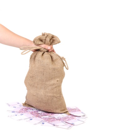 rescheduling: Hand holds bag with euro banknotes. Isolated on a white background.