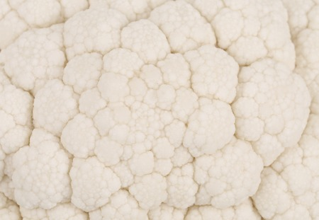 Closeup of tasty spring ripe cauliflower pattern. Isolated on a white background. photo