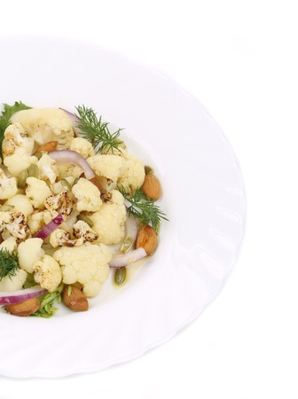 Cauliflower salad with nuts and red onion. Isolated on a white background. photo