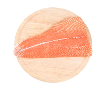 Raw salmon fish on cutting board. Isolated on a white background. photo