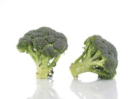 Two fresh broccoli. Isolated on a white background. photo