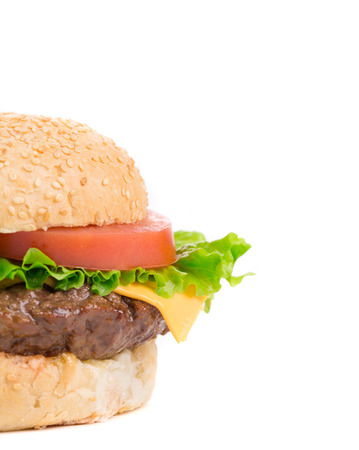 Close up of tasty hamburger. Isolated on a white background. photo