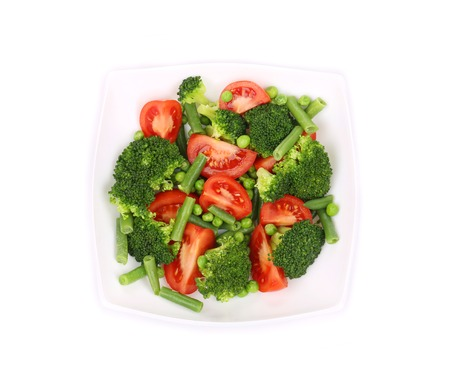 Broccoli salad with tomatoes. Isolated on a white background. photo