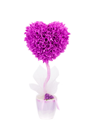 Plastic bush tree heart shape. Isolated on a white background. photo