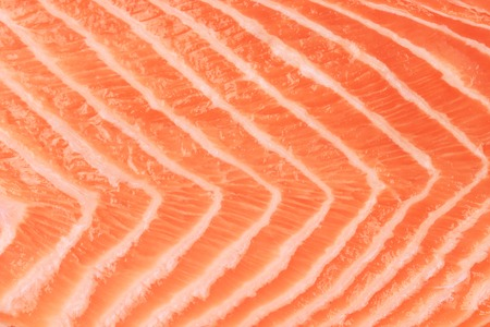 Closeup of beautiful raw salmon steak on cutting board. photo