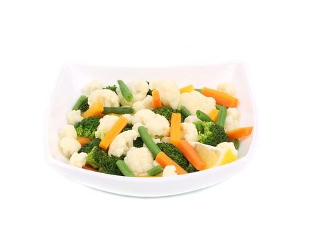 brocoli: Broccoli and cauliflower salad. Isolated on a white background. Stock Photo
