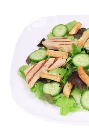 Beautiful caesar salad. Isolated on a white background. photo