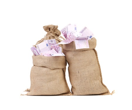 rescheduling: Two full bags with euro banknotes. Isolated on a white background.