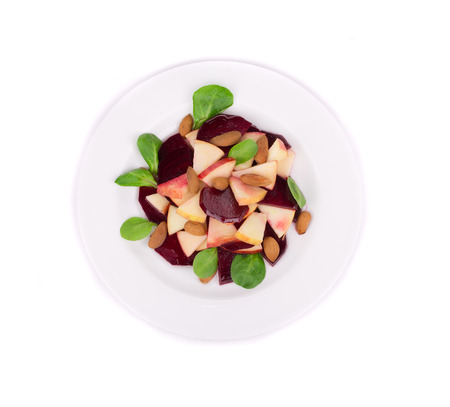 Beet salad with spinach and minced apple. Isolated on a white background. photo