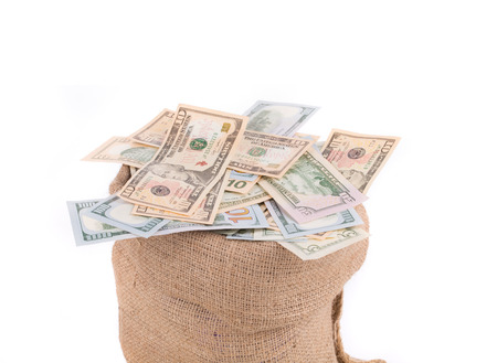 Sack full of money. Isolated on a white background. photo