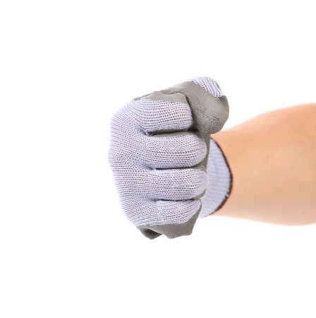 Worker hand glove clenching fist. Isolated on a white background. photo