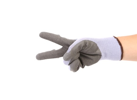 Hand in glove showing two. Isolated on a white background. photo