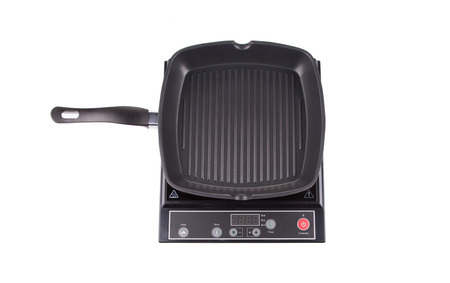 Modern electric stove surface. Isolated on a white background.